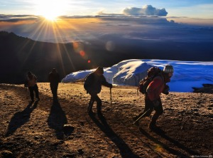 Summiting Kilimanjaro climb with snow sunrise